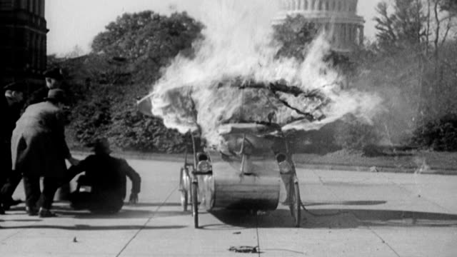 Triphibian car is tested in Washington / strange looking vehicle comes around a corner with Capitol building in the background / vehicle begins to...