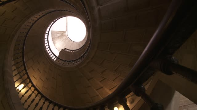 triple helicoid stairs made of bricks wind up to the upper story of a convent. - spiral staircase stock videos & royalty-free footage