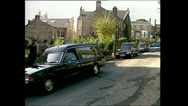 Triple murderer challenges his 'life' sentence LIB Hearses pull up in road at funeral of Basil Avril and Richard Laitner Coffin taken out of hearse