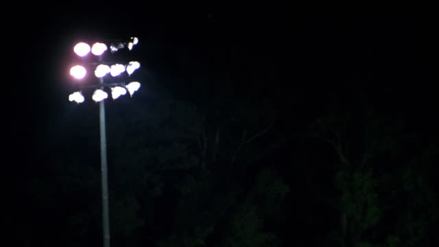 AERIAL CU ZO WS Triple-A baseball game with floodlights