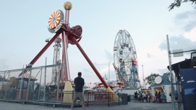 tripod shot of an amusement park ride at coney island. - coney island stock videos & royalty-free footage