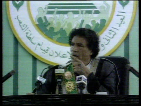 LIB LIBYA Tripoli CMS Colonel Moammer Khadafi seated making speech CF = B0545004 or B0544447 202255 to 202318 FX Order Ref T09010004