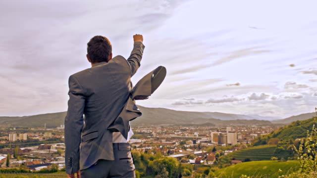 slo mo triumphant businessman punching the air - human limb stock videos & royalty-free footage