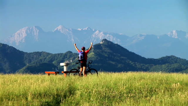 hd: triumphant mountainbiker - human limb stock videos & royalty-free footage