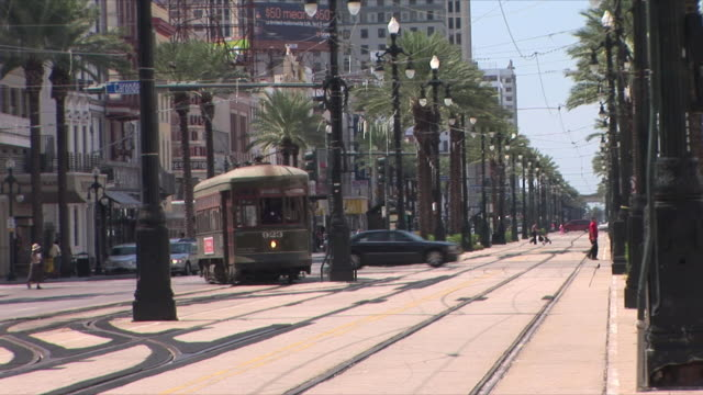 ws trolley and pedestrians in canal street, new orleans, louisiana, usa - new orleans stock videos & royalty-free footage