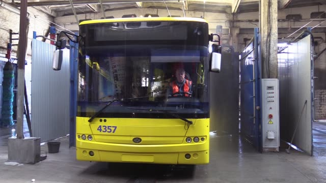 a trolley bus is being washed for disinfection as part of precautionary measures against the spread of the covid19 coronavirus at a trolleybus depot... - trolley bus stock videos & royalty-free footage
