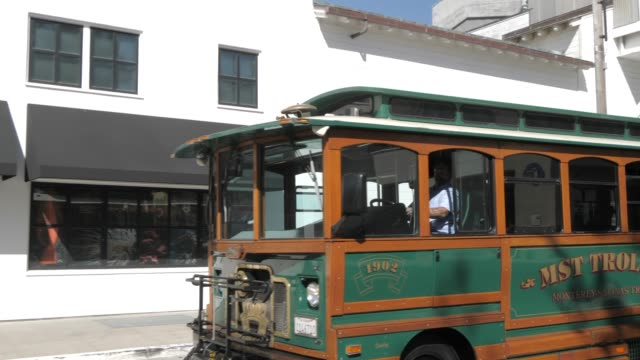 trolley bus on cannery row, monterey peninsula, california, united states of america, north america - trolley bus stock videos & royalty-free footage