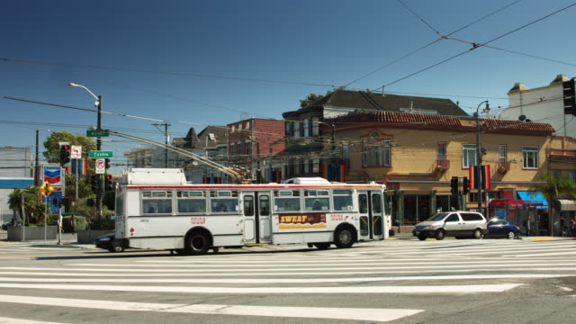 trolley buses and cars at castro and market, san francisco - trolley bus stock videos & royalty-free footage