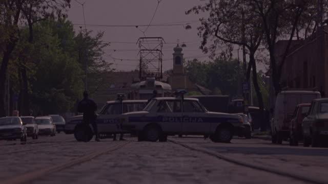 vídeos de stock e filmes b-roll de a trolley crashes into police cars, bursting them into flames. - autocarro elétrico