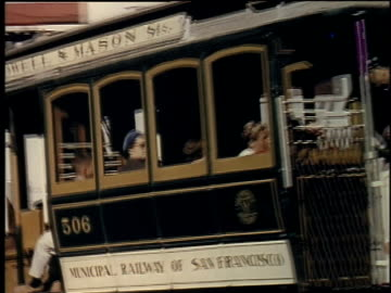 1957 ts trolley going down hilly street with people riding / san francisco, california, united states - 1957 stock videos & royalty-free footage