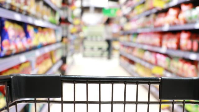 vidéos et rushes de chariot magasin, chariot de supermarché - store