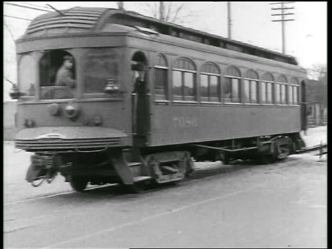 B/W 1919 trolley passing on city street + two cars having collision / newsreel