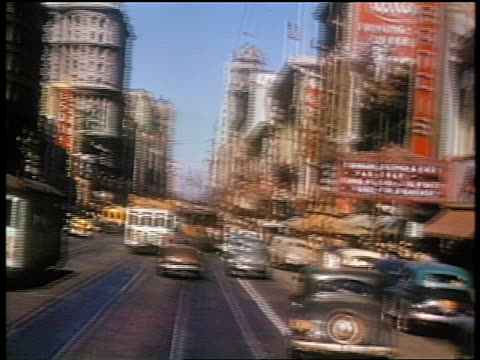 1941 trolley point of view down busy street / Market Street, San Francisco / amateur industrial