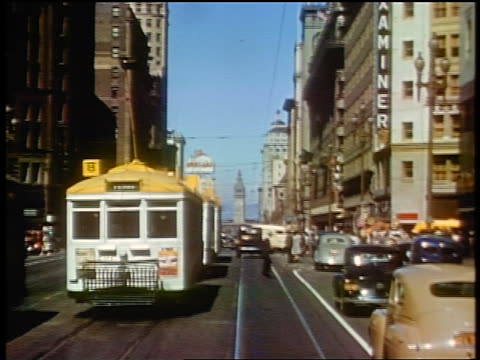 1941 trolley point of view down busy street / market street, san francisco / amateur industrial - tram point of view stock videos and b-roll footage