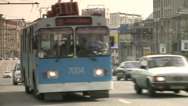 a trolley-car flows with the traffic in moscow, russia. available in hd. - 2005 stock videos and b-roll footage