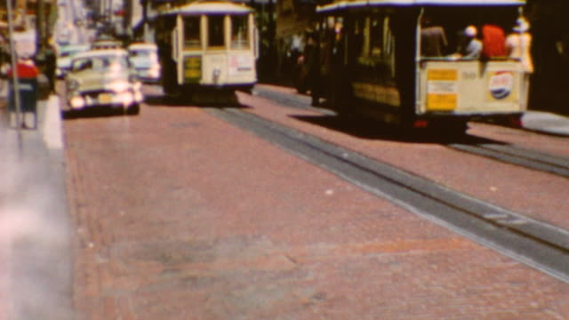 trolleys riding on track / pedestrians boarding trolley / pov of riding the car on hills / san francisco trolleys on june 01 1960 in san francisco... - home movie stock videos & royalty-free footage
