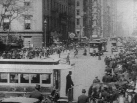 b/w 1904 trolleys + traffic on wide intersection of broadway and fulton street / nyc / documentary - 1904 stock videos & royalty-free footage
