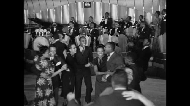 trombone player in big band int ws rainbow room w/ upscale people dancing dance floor harlem savoy sign 'crazy swing' int savoy ballroom w/... - ballroom stock videos & royalty-free footage