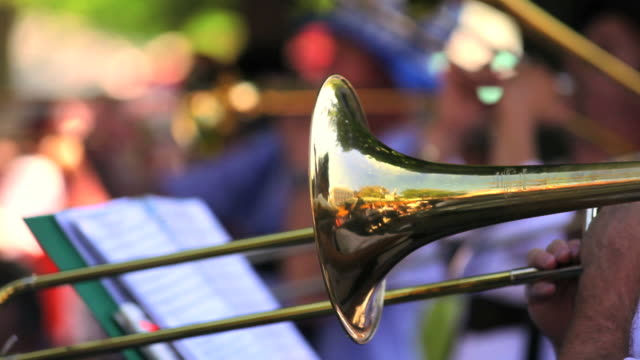 trombone players in open air concert closeup - fröhlich stock videos & royalty-free footage