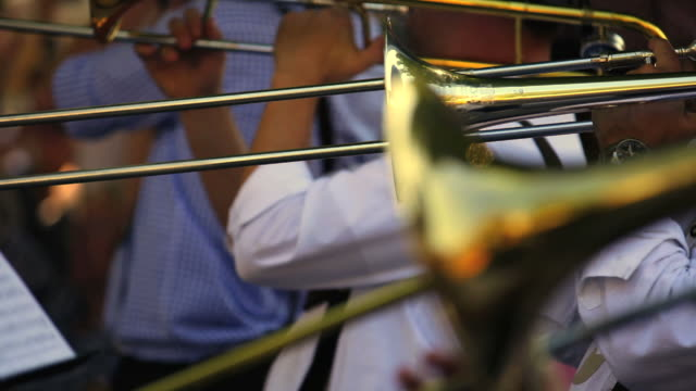 trombone players on open air concert close-up - marching band stock videos & royalty-free footage
