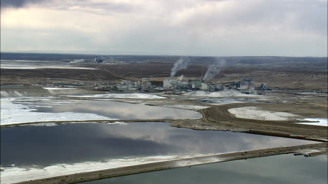 trona mining plant one  - aerial view - wyoming, sweetwater county, united states - wyoming stock videos & royalty-free footage