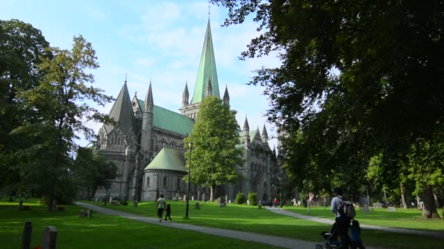 trondheim norway cruise hurtigruten the famous nidaros domkirke church with steeple and green area all over - steeple stock videos & royalty-free footage