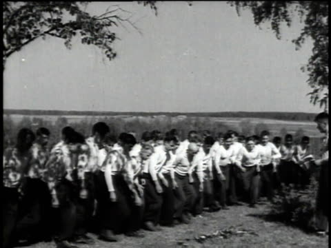 troop recruitment / troops grab items in dirt / recruits running through woods - former soviet union stock videos & royalty-free footage
