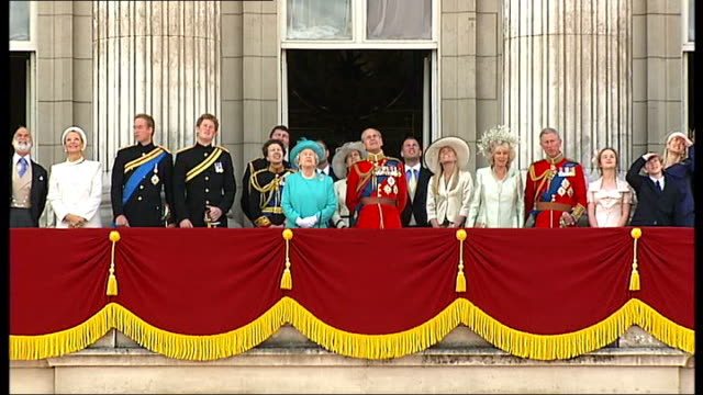 trooping of the colour ceremony crowd gathered outside palace / queen out onto balcony with prince philip prince charles prince william and prince... - trooping the colour stock videos & royalty-free footage