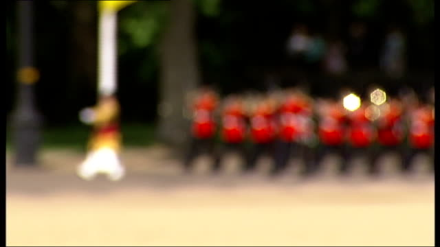 london horse guards parade ext military band marching along seen behind ranks of troops in parade formations on horse guards parade / soldiers... - horse guards parade stock videos and b-roll footage