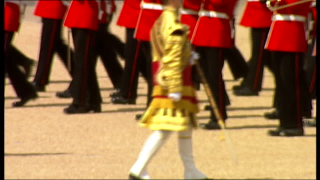 trooping of the colour ceremony military band marching along on parade ground / princes anne on horse / royal horse artillery / soldiers parading... - british military stock videos & royalty-free footage