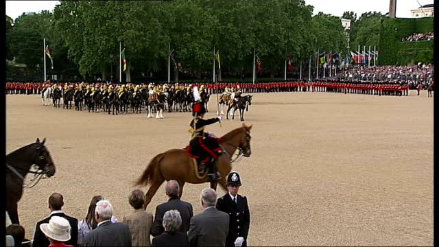 trooping of the colour ceremony people watching from windows overlooking horse guards parade / spectators / soldiers parading and military band... - royal horse artillery stock videos and b-roll footage