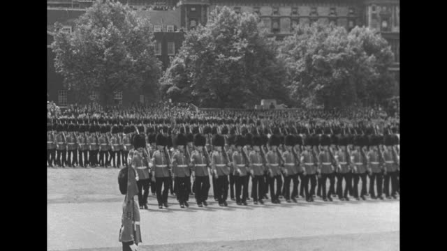 trooping the colour at horse guards parade / queen elizabeth ii takes the salute / prince henry duke of gloucester is next to the queen / blues and... - 近衛兵点の映像素材/bロール