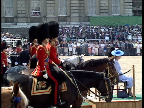 trooping the colour ceremony horseguards parade **music heard intermittently sot** prince harry and prince william watching / guards and bands... - nodding head to music stock videos and b-roll footage