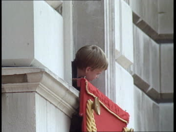 stockvideo's en b-roll-footage met trooping the colour ceremony; horseguards parade: **music heard intermittently sot** prince william leaning out of window / queen elizabeth ii stands... - optocht