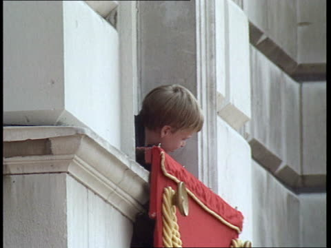trooping the colour ceremony; horseguards parade: **music heard intermittently sot** prince william leaning out of window / queen elizabeth ii stands... - 軍旗分列行進式点の映像素材/bロール