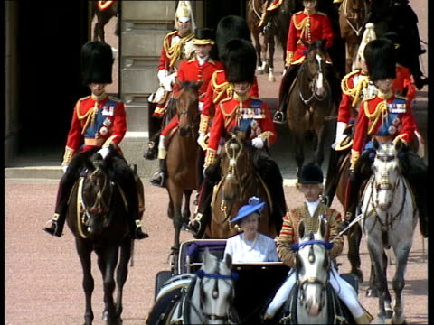 Trooping the Colour ceremony ITN London Buckingham Palace EXT **Music heard intermittently SOT** Buckingham Palace and coach out from palace with...