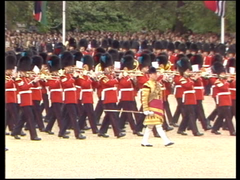 trooping the colour; england: london: horse guards parade charles mounted looks round march past colour handed to ensign side: charles salutes... - 軍旗分列行進式点の映像素材/bロール