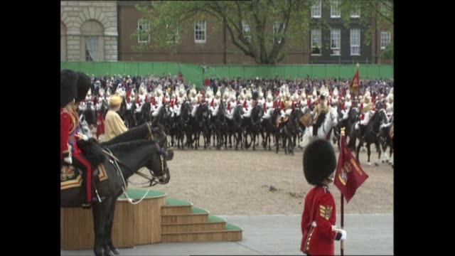 london: horse guards parade: ext **band playing various pieces of music including national anthem in background sot** bv queen elizabeth standing on... - cavalry stock videos & royalty-free footage