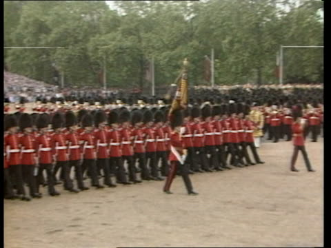 trooping the colour; england: london: horseguards parade lts horse guards marching towards at the trooping of the colours cms side queen in uniform... - 軍旗分列行進式点の映像素材/bロール