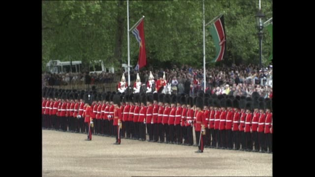itn england london horse guards parade ext **band playing various pieces of music including national anthem in background sot** ls guards marching... - blue background stock videos & royalty-free footage