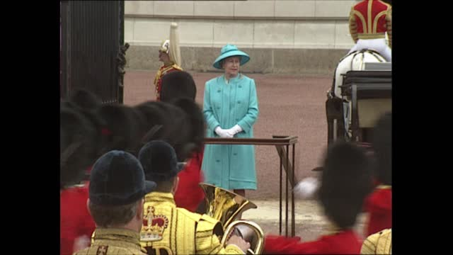 stockvideo's en b-roll-footage met queen and royal family attend; england: london: horse guards: ext gvs new colour paraded in front of queen elizabeth ii standing on podium new colour... - new not politics
