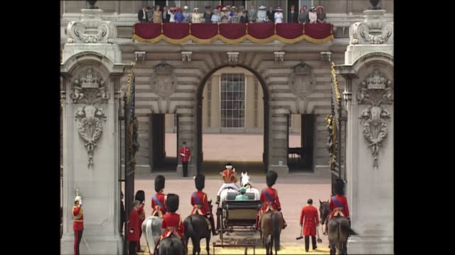 queen's official birthday england london ext queen elizabeth ii standing on podium by buckingham palace gates as troops march past prince philip duke... - resting stock videos & royalty-free footage