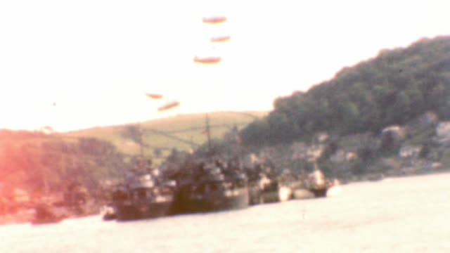 vídeos y material grabado en eventos de stock de troops and cargo aboard dday invasion vessels / blimps above lst craft / dartmouth castle on english coast / leaving england / on the north sea /... - devon
