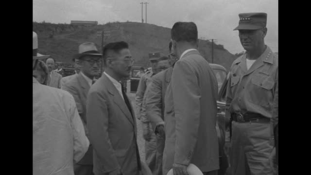 vídeos de stock, filmes e b-roll de troops at attention salute / under an open air stage an asian man presents document to another / rhee and wife francesca donner arrive and they shake... - moving activity