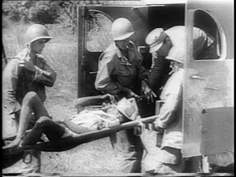 troops battle for control of the philippines / natives carry supplies / soldiers trek on field / soldiers using mortars / japanese air raid hits... - vittima di incidente video stock e b–roll