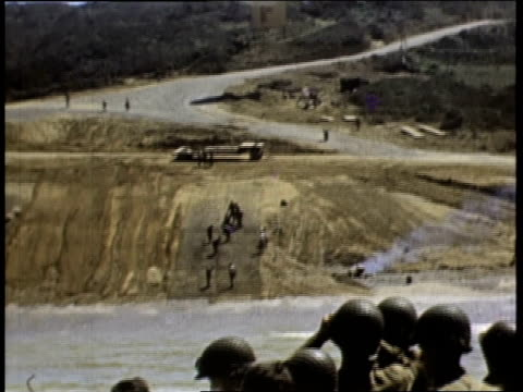 troops building ramp and unloading tanks from ships / normandy, france - 1944 stock videos & royalty-free footage