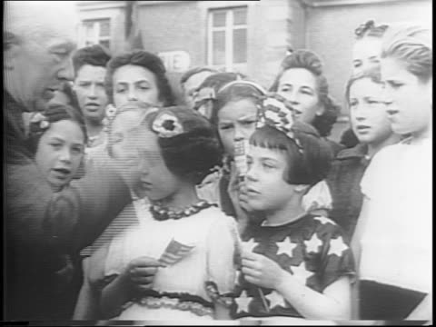 us troops celebrate the fourth of july in french villages / families and children line the streets on the fourth of july in a village in france /... - 1944 stock videos & royalty-free footage