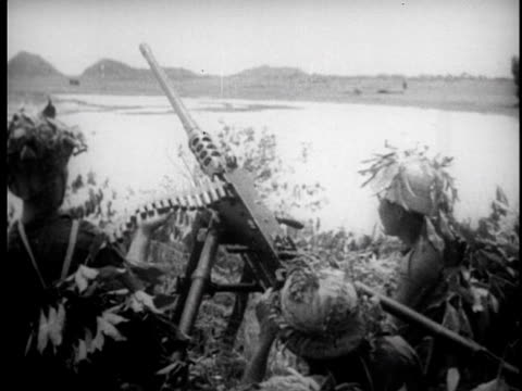 troops commence firing on targets with artillery / soldiers move into position for attack / firing machine guns and canon / wounded are taken off... - north vietnam stock videos and b-roll footage