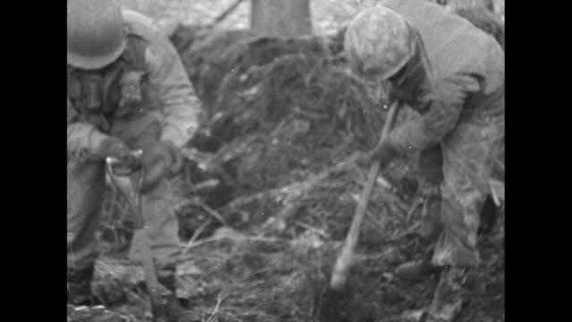 VS US troops digging in trench / AfricanAmerican soldier with jackhammer / digging activity / two AfricanAmerican soldiers use pickax and shovel / VS...