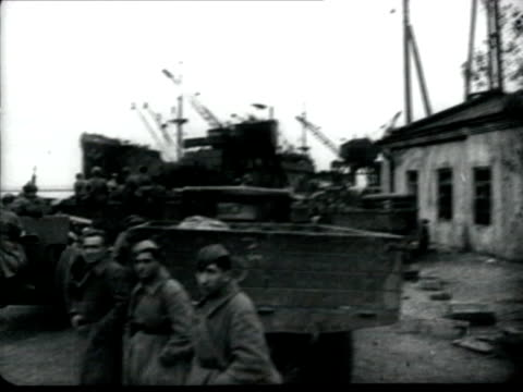 troops evacuating by ships - soviet warship chervona ukraina covering the retreat - troops moving through dirty roads - soviet military stock videos & royalty-free footage